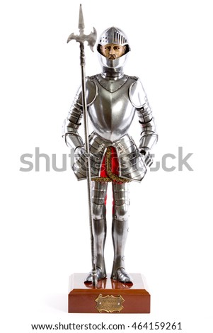 doll of a medieval knight in armor with a lance