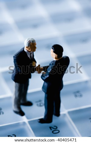 Doll of the businessman who communicates on the schedule. - stock photo
