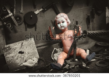 doll old children's toys dolls with green eyes horror and fear scary stories fairy tale terrible  - stock photo