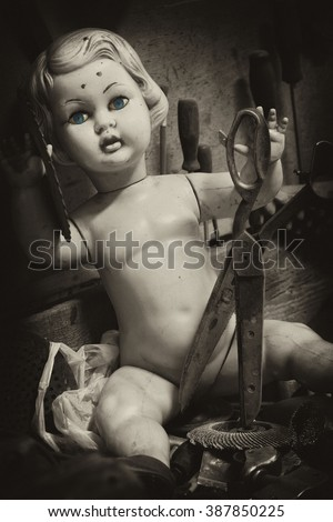 doll terrible old children's toys dolls with green eyes - horror and fear - scary stories  - a fairy tale - stock photo