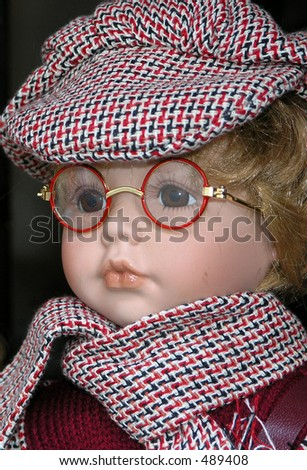 doll with glasses and hat - stock photo