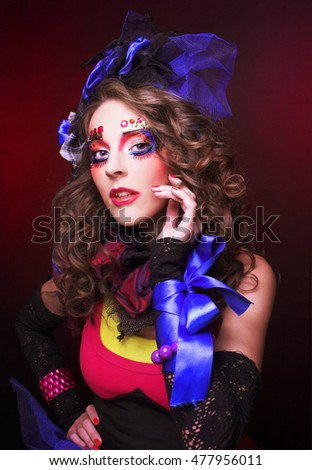 Doll. Young woman in bright holiday image.