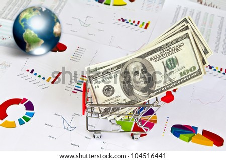 Dollar and business graph with earth (Elements of this image furnished by NASA)