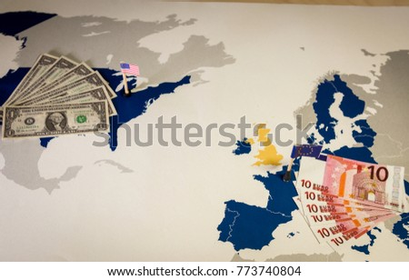 dollar and euro american and euan flags over eu and us map symbolizing the