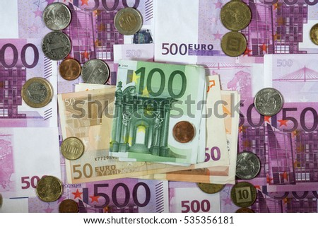 dollar and euro. dollars banknotes on the background of the banknotes of 500 euros. lie in disarray