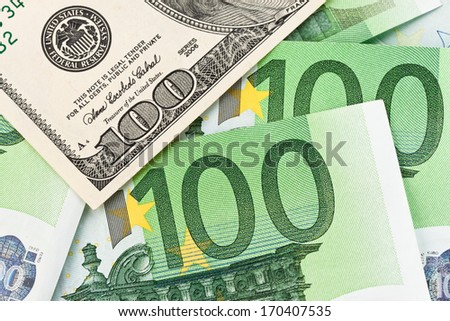 dollar and euro notes. symbol differences euro dollar - stock photo