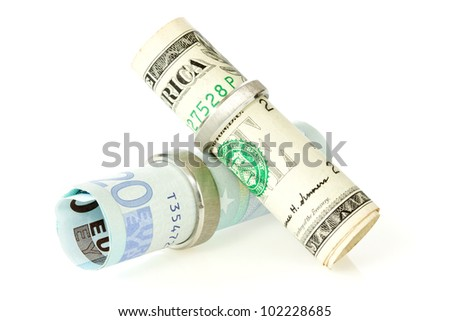 dollar and euros with a  wedding rings