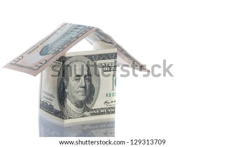 Dollar and houses isolated over white. - stock photo