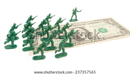 dollar attack: usa soldiers over a one dollar bill
