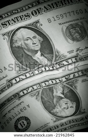 Dollar banknote in close up with reflection