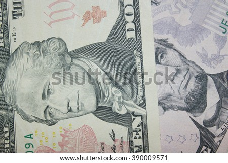 dollar banknotes 5 and 10 with images of presidents - stock photo