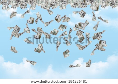 Dollar banknotes falling down on cloudy sky background. - stock photo