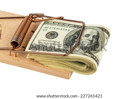 dollar banknotes in a mousetrap. symbol photo for debt - stock photo