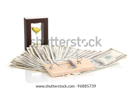 Dollar banknotes with sandglass and mousetrap isolated on white - stock photo
