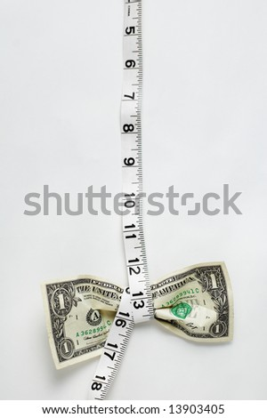 Dollar being squeezed by measuring tape, low hang. - stock photo