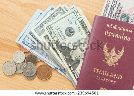 dollar bills and coins passport - stock photo