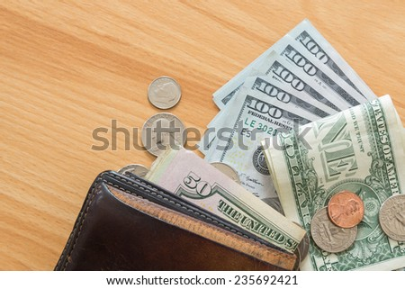 dollar bills and coins wallet - stock photo