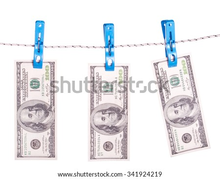 Dollar bills hanging on rope attached with clothes pins. Money-laundering concept. - stock photo