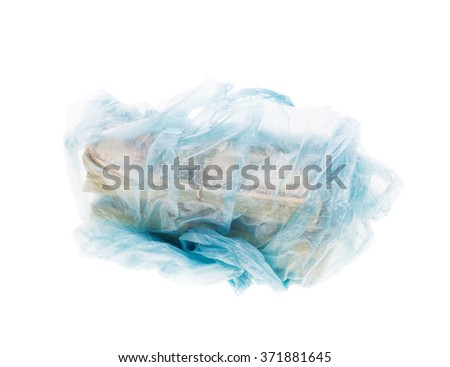 Dollar bills in stacks wrapped in a plastic shopping bag isolated on white background