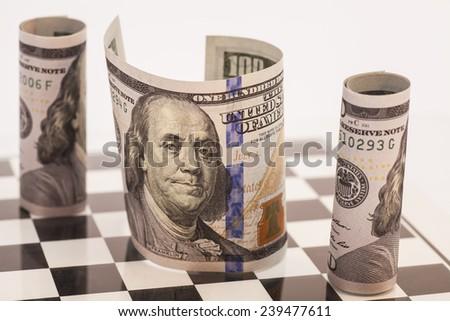Dollar bills on a chess board  - stock photo