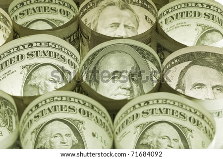 Dollar bills rolled - money background in sepia color tones