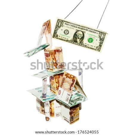 dollar breaks the house built from rubbles on white background - stock photo