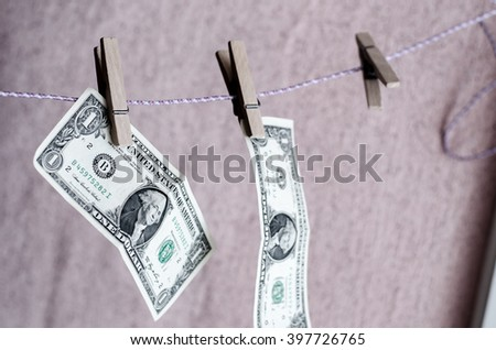 dollar clothespin - stock photo