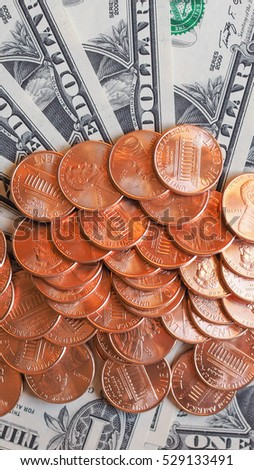 Dollar coins and banknotes  currency of the United States useful as a background - vertical