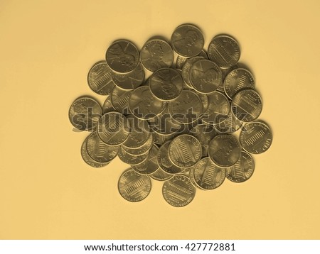 Dollar coins 1 cent currency of the United States - vintage sepia look - stock photo