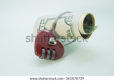 Dollar currency notes with lock and chain. money stack for safety. - stock photo