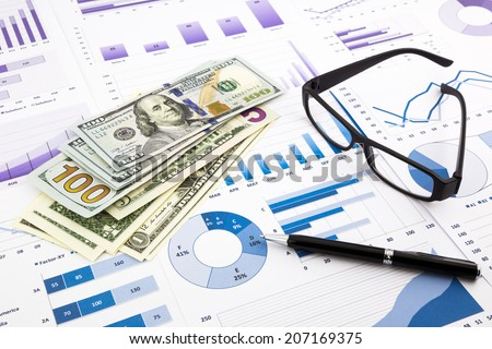 dollar currency on financial charts, expense cash flow summarizing and graphs background, concepts for saving money, budget management, stock exchange and business income report - stock photo