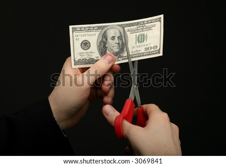 dollar cutting by scissors - stock photo
