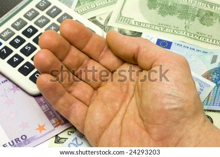 Dollar, euro banknotes, calculator and human hand