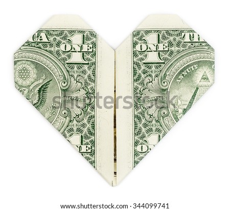 Dollar folded into heart isolated on white background. Valentine's heart. - stock photo