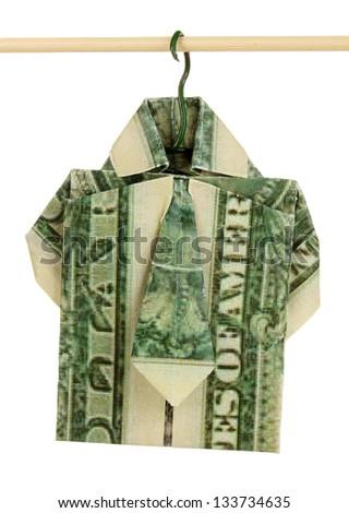 Dollar folded into shirt on hanger isolated on white - stock photo