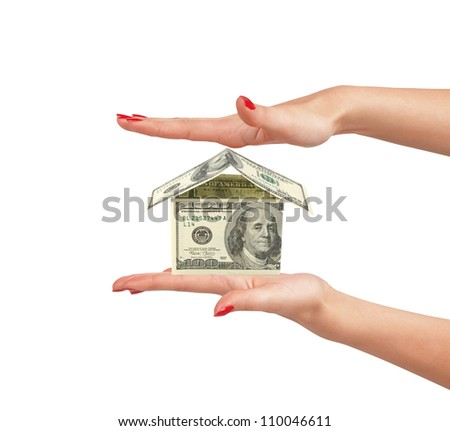 dollar house on woman hand isolated on white background - stock photo