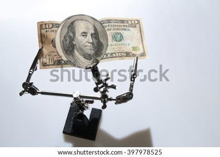 Dollar ,Magnifying Glass - stock photo