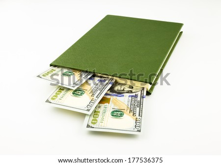 dollar money banknotes and book, school fee, budget and business concept - stock photo