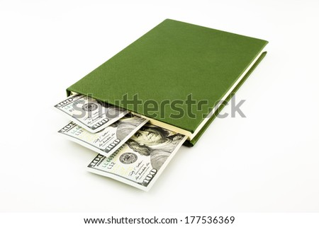 dollar money banknotes and book, tuition fee, income and business concept - stock photo