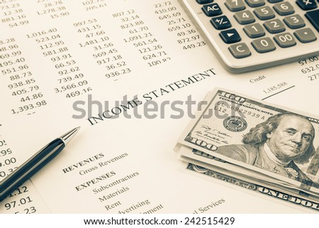 Dollar money place on business income statement with detail list of revenues and expenses, financial reports on background, sepia tone image