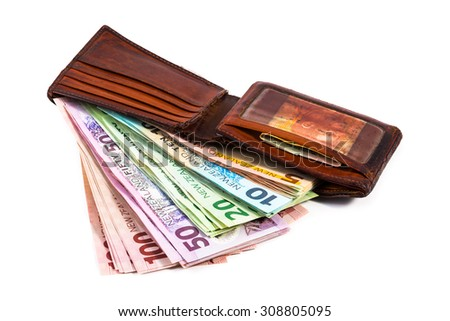 Dollar notes in New Zealand currency in an old wallet isolated on white - stock photo