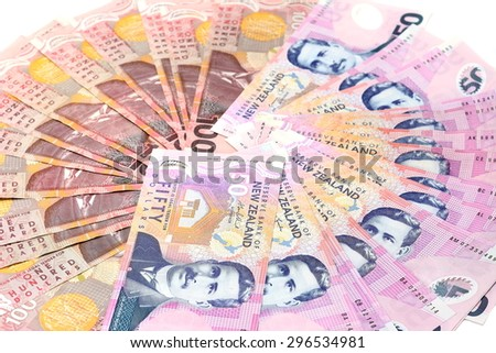 Dollar notes in New Zealand currency $100 $50 on white background - stock photo
