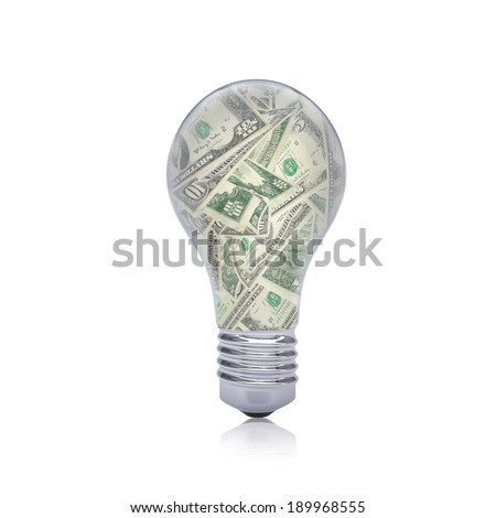 Dollar notes inside the bulb. Business concept