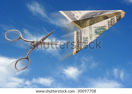 dollar plane and scissors on blue background - stock photo