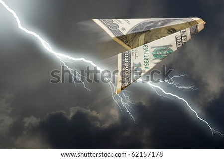 dollar plane and thunderstorm - stock photo