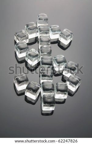 Dollar Sign Formed by Ice Cubes with Reflection - stock photo