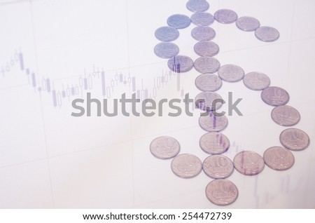 Dollar sign from coins & stock chart as background. - stock photo