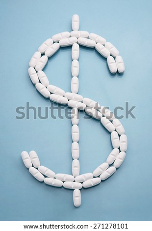 Dollar sign icon made of drug pills - stock photo