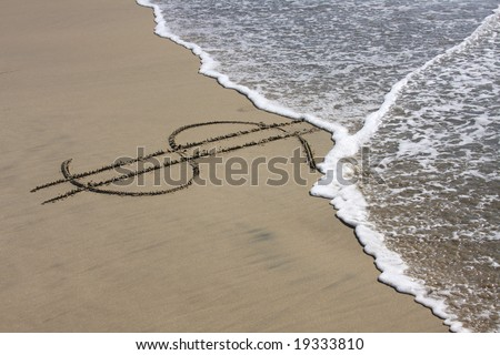 Dollar sign in beach sand being washed away - stock photo