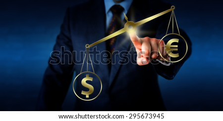 Dollar sign is outweighing a Euro symbol on a golden weight scale. Hand of a businessman is positioning the virtual balance in space. Metaphor for currency transaction in the global financial market. - stock photo